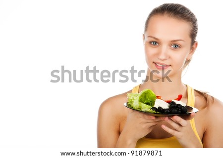 closeup portrait of young woman with plate of vegetable salad, girl with plate of greek salad, caucasian beauty  with vegetarian salad, on white background, studio shot - stock photo