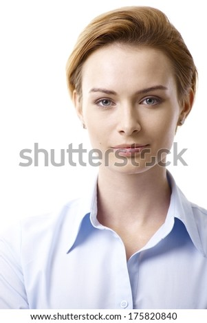 Closeup portrait of young woman with pure face, looking at camera. - stock photo