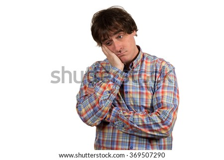 Closeup portrait of young worried man.  Negative emotion, facial expression, feelings... isolated on white background. - stock photo