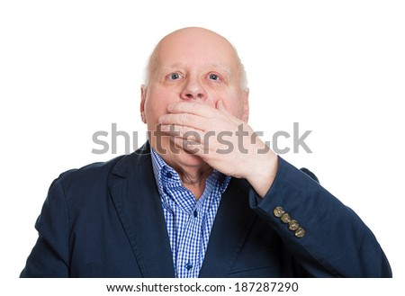 Closeup portrait, old man, senior citizen, worker, employee, covering his mouth. Speak no evil concept, isolated white background. Human emotions, face expressions, feelings, signs, body language - stock photo