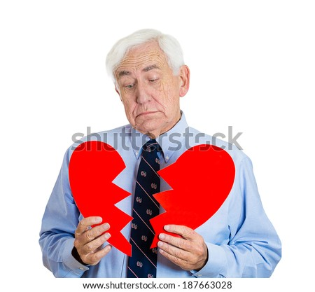 Closeup portrait, old man, senior executive, businessman, corporate employee, mature guy, holding broken heart in his hands, about to cry, isolated white background. Human emotions, expressions - stock photo