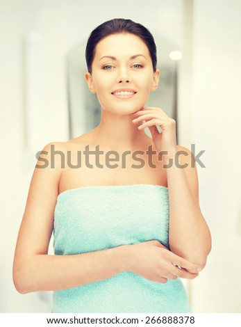 closeup portrait picture of beautiful woman in towel - stock photo
