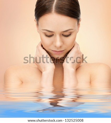 closeup portrait picture of beautiful woman in water - stock photo