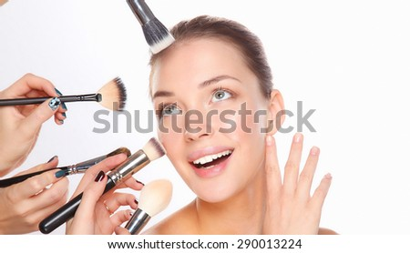 Closeup portrait picture of beautiful woman with brushes. - stock photo