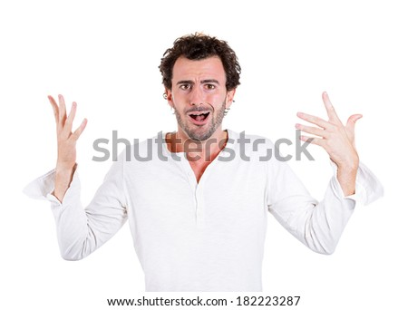 Closeup portrait playing dumb, clueless young man, arms out asking what's problem, who cares, so what I don't know isolated white background. Negative emotions, facial expressions, attitude, reaction