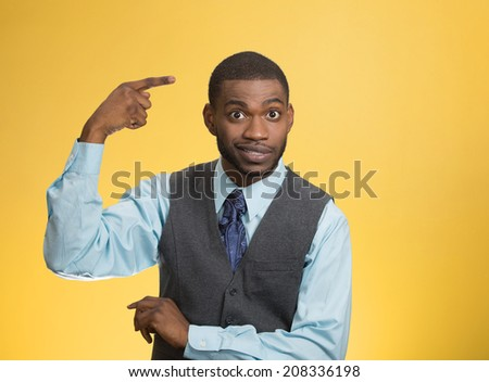 Closeup portrait rude, difficult, angry young executive businessman gesturing with fingers against temple, are you crazy? Isolated green background. Negative human emotion, facial expression, feelings - stock photo