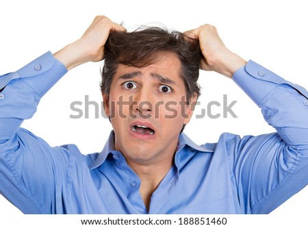 Closeup portrait sad, confused, unhappy, frustrated, stressed young man, pulling his hair out, expecting bad news, isolated white background. Negative human emotions, facial expression, reaction - stock photo
