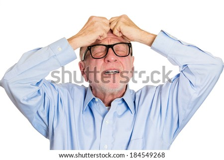 Closeup portrait, sad, senior mature business man in big black glasses, suffering from severe migraine, receiving bad news, isolated white background. Geriatrics, depression, health issues. Emotions - stock photo