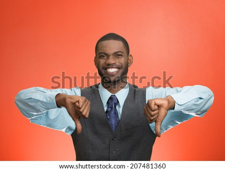 Closeup portrait sarcastic young man showing two thumbs down sign hand gesture, happy that someone made mistake, lost, failed isolated red background. Negative emotions, facial expressions, feelings - stock photo