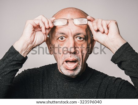 Closeup portrait senior, elderly man in glasses, looking shocked, open mouth - stock photo