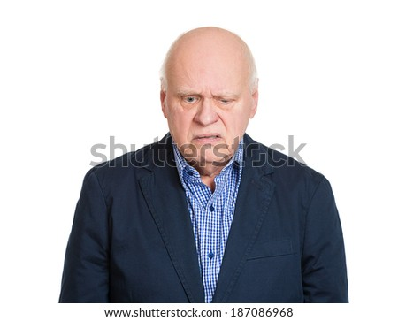 Closeup portrait, senior elderly mature depressed man really sad, deep in thought, thinking realizing truth looking down isolated, white background. Human face expression emotion feeling, reaction