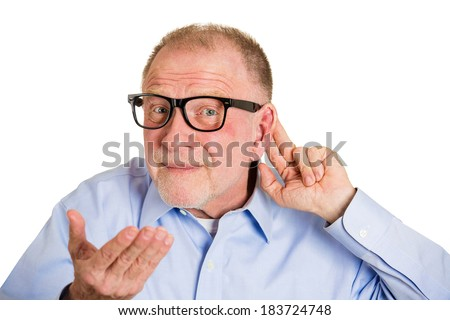 Closeup portrait, senior man, nerd black glasses, hard of hearing, placing hand on ear asking someone to speak up, isolated white background. Negative emotion, facial expressions, feelings. - stock photo