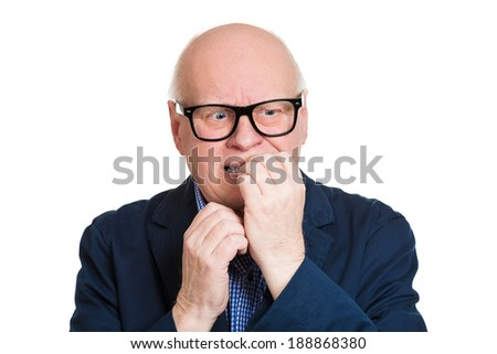 Closeup portrait, senior man, unhappy, scared nerd black glasses, biting nails, looking crazy with craving for something, anxious worried, isolated white background. Negative funny face expression - stock photo