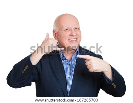 Closeup portrait senior mature, bald man, worker making call me gesture sign with hand shaped like phone, pointing to return call, isolated white background. Positive emotions, face expressions - stock photo
