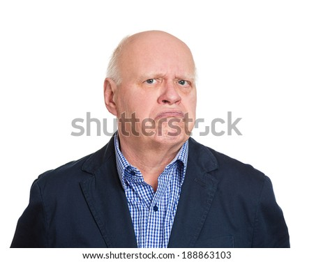 Closeup portrait, senior mature business man, funny, suspicious, annoyed looking being cautious, careful, attentive, thinking, of his own mind, isolated white background. Emotion, facial expression