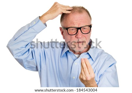 Closeup portrait senior mature man in big black glasses, feeling head, surprised he is losing hair, receding hairline, isolated white background. Negative facial expressions, emotion feeling - stock photo
