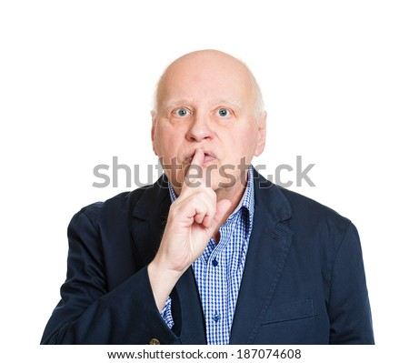 Closeup portrait, senior, serious, mature man placing finger on lips with shhh sign symbol, isolated white background. Negative human emotions, facial expressions, body language, attitude, control - stock photo