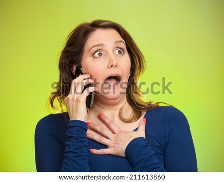 Closeup portrait shocked business woman, employee talking on cell phone having unpleasant conversation, receiving shocking news isolated green background. Negative emotion facial expression reaction - stock photo