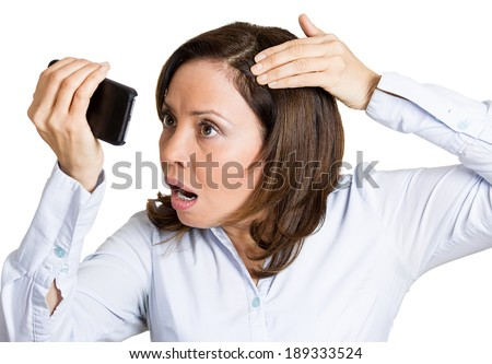 Closeup portrait, shocked funny looking mature woman, feeling head, surprised she is losing hair, receding hairline, upset, isolated white background. Negative facial expression emotion, reaction. - stock photo