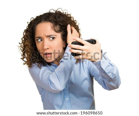 Closeup portrait, shocked funny looking young woman, feeling head, surprised she is losing hair, receding hairline, upset, isolated white background. Negative human facial expression emotion, reaction - stock photo