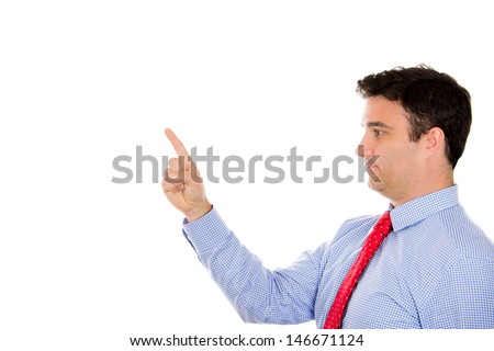 Closeup portrait side profile of handsome businessman pointing with index finger at copy space, isolated on white background - stock photo