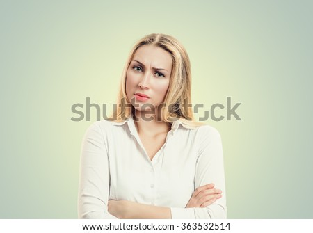 Closeup portrait, skeptical, serious senior young woman looking suspicious, disapproval on face, arms crossed folded, isolated white background. Negative human emotion, facial expressions, feelings - stock photo