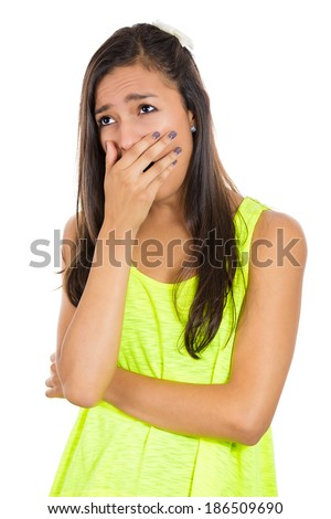 Closeup portrait, sleepy young woman, student placing hand on mouth yawning, looking awayy, isolated white background. Negative human emotions, facial expressions, feelings, signs and symbols - stock photo