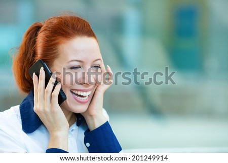 Closeup portrait, smiling attractive successful businesswoman, entrepreneur, corporate employee talking on cellphone, walking in company building, isolated background office windows. Positive emotion