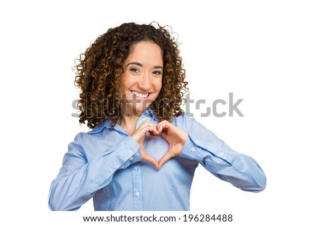 Closeup portrait smiling, cheerful, happy, young woman making heart sign with hands, isolated white background. Positive human emotions, expressions, feelings, life perception, attitude, thinking - stock photo