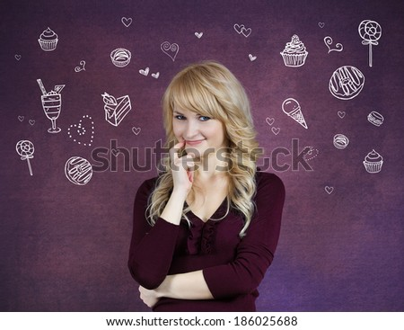 Closeup portrait smiling young woman, hand on cheek looking at you imagining, craving snacks, isolated purple background with dessert vectors. Positive emotions, facial expressions, feelings, attitude - stock photo