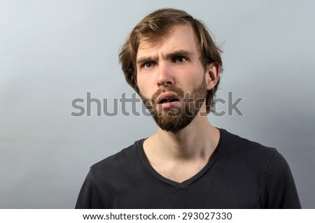 Closeup portrait speechless, insulted shocked, stunned surprised young man, in disbelief isolated grey background. Negative human emotion, facial expression, bad feelings, body language, panic attack - stock photo