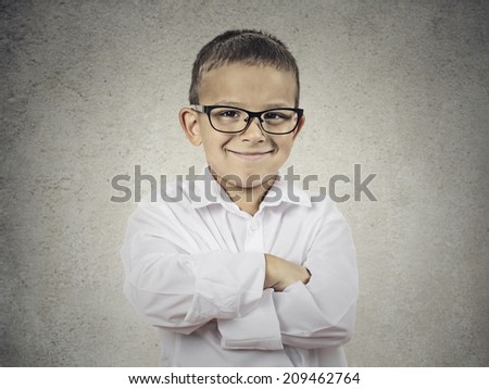 Closeup portrait standing, smiling child, Boy, happy young man with hands folded, isolated grey wall background. Positive human emotions, face expressions, life perception, body language - stock photo
