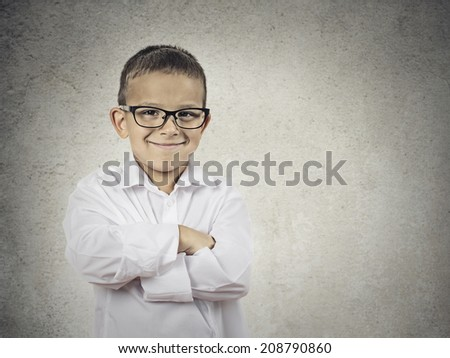Closeup portrait standing, smiling little Boy, happy young man with hands folded, isolated grey, black background copy space. Positive human emotions, face expressions, life perception, body language - stock photo
