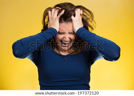 Closeup portrait  stressed business woman, pulling her hair out, yelling, screaming with temper tantrum isolated yellow background. Negative human emotions, facial expressions, reaction attitude - stock photo