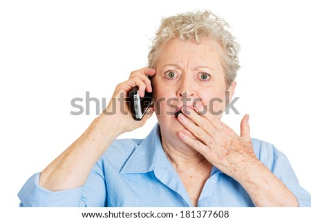 Closeup portrait stressed shocked elderly business woman, senior lady talking on cellular, having unpleasant conversation receiving bad news isolated white background. Human emotion, facial expression - stock photo