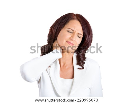 Closeup portrait stressed unhappy business woman with bad neck pain, after long hours of work or studying, isolated on white background. Negative human emotion facial expression feelings
