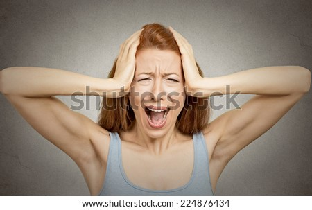 Closeup portrait stressed woman covers ears with hands yelling screaming with temper tantrum isolated grey wall background. Negative human emotions, facial expressions, feelings reaction attitude - stock photo