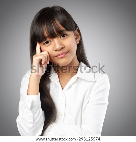 Closeup portrait stressful little asian girl hands on head, Isolated on grey background - stock photo