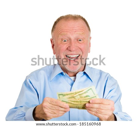 Closeup portrait, super happy, excited, successful senior mature man holding money dollar bills in hand, isolated white background. Positive emotion facial expression feeling. Financial reward savings - stock photo