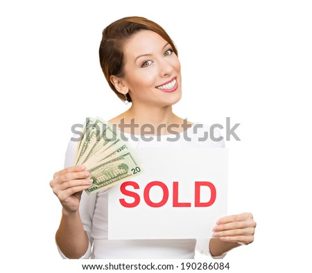 Closeup portrait, super happy excited successful young business woman holding money dollar bills in hand and red sold sign, isolated white background. Positive emotion feeling. Financial reward - stock photo