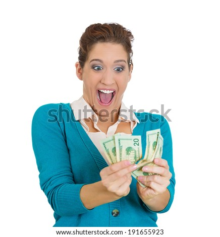 Closeup portrait super happy excited successful young woman holding money dollar bills in hand isolated white background. Positive emotion facial expression feeling reaction. Financial reward savings