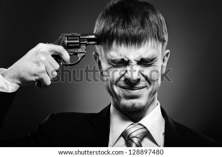 closeup portrait  the  beautiful  businessman careerist in black costume to commit suicide, black-and-white - stock photo