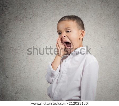 Closeup portrait tired child yawning, funny looking boy isolated grey wall background. Human facial expression, emotion, feeling, body language. Long school hours, busy day concept, lack of motivation - stock photo