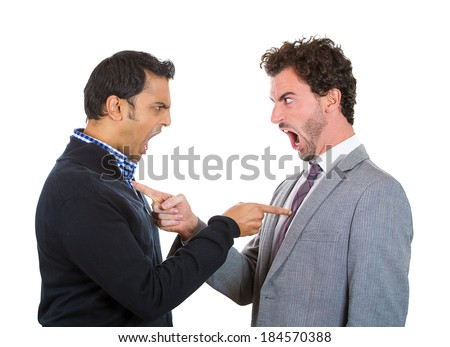 Closeup portrait, two angry men pointing fingers at each other blaming for problems, isolated white background. Interpersonal conflict. Negative human emotions facial expression feeling, body language