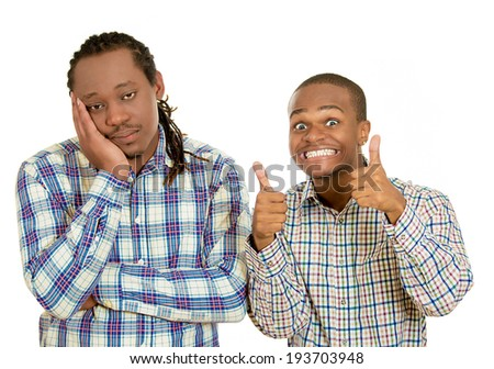 Closeup portrait two businessmen, friends, one being excited, smiling, happy giving  thumbs up, other serious, concerned, gloomy, bored, depressed isolated white background. Emotion, feelings contrast