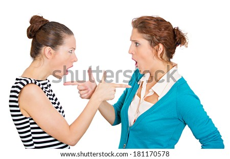 Closeup portrait two mad angry women with bad attitudes getting into argument fighting, pointing fingers at each other isolated white background. Negative emotions, facial expression feeling reaction  - stock photo