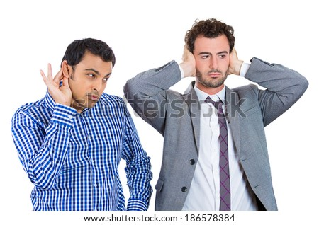 Closeup portrait two workers, business men, corporate, government employees, one alert, curious, interested, second state of denial, ignoring, covering ears isolated white background. World polarity