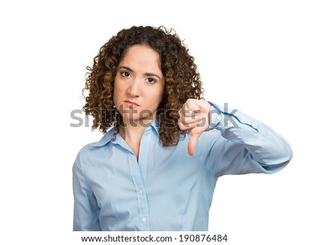 Closeup portrait unhappy angry, mad pissed off woman, annoyed wife, giving thumbs down gesture, looking with negative facial expression, disapproval, isolated white background. Human emotion, reaction - stock photo