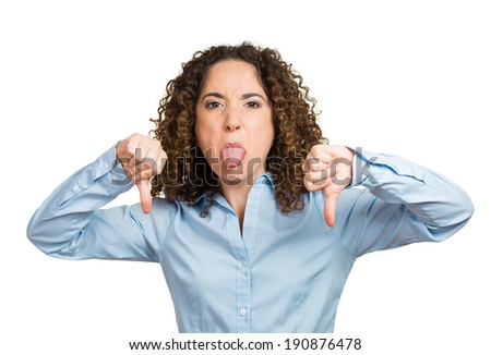 Closeup portrait unhappy angry, mad woman, annoyed, giving thumbs down gesture, sticking out tongue looking, negative facial expression, disapproval, isolated white background. Human emotion, reaction - stock photo