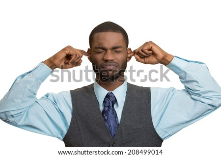Closeup portrait unhappy, annoyed man plugging closing ears with fingers, disgusted ignoring something not wanting to hear someone side story, isolated white background. Human emotion body language - stock photo